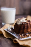 Chocolate orange cake with butter cream and toasted walnuts. Chocolate dessert, restaurant, wooden background Royalty Free Stock Images