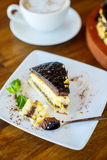 Chocolate orange cake and cappuccino Royalty Free Stock Photos