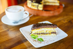 Chocolate orange cake and cappuccino Stock Photography