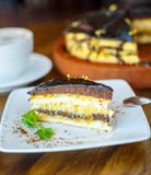 Chocolate orange cake and cappuccino Royalty Free Stock Photography