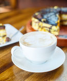 Chocolate orange cake and cappuccino Stock Image