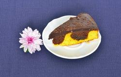 Chocolate orange cake and chrysanthemum flower Royalty Free Stock Photography