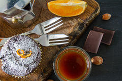 Chocolate and orange cupcake with coffee Royalty Free Stock Image