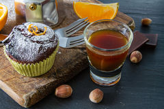 Chocolate and orange cupcake with coffee Royalty Free Stock Images
