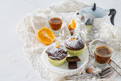Chocolate and orange cupcake with coffee Stock Image