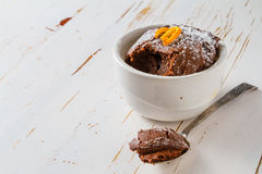 Chocolate and orange cupcake with coffee Stock Photos