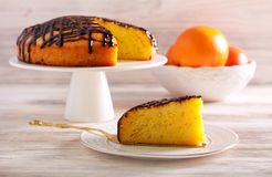 Chocolate and orange drizzle cake, served. On plate stock images