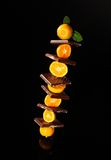 Chocolate with orange mandarin. On black background Royalty Free Stock Photo