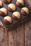 Chocolate-orange muffins from the oven. vertical top view Stock Images