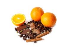 Chocolate, orange, spices isolated on white Stock Photo