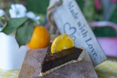 Chocolate orange tart with orange fruit royalty free stock photo