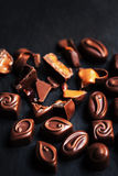 Chocolate over black background. Chocolate Candy, Cocoa. Assortm Royalty Free Stock Photography