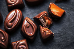 Chocolate over black background. Chocolate Candy, Cocoa. Assortm Stock Image