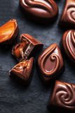 Chocolate over black background. Chocolate Candy, Cocoa. Assortm Royalty Free Stock Images