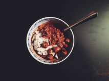 Chocolate overnight oats in bowl with hazelnuts and coconut Royalty Free Stock Image