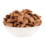 Chocolate pads corn flakes in white bowl isolated on white background. Cereals. Stock Photography