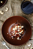 Chocolate pancake with bananas, nuts and chocolate sauce Royalty Free Stock Image
