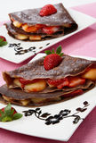 Chocolate pancake with fruit Stock Image