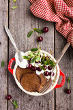 Chocolate pancake with sour cream and sweet cherry for breakfast or pancake day Royalty Free Stock Photos