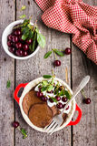Chocolate pancake with sour cream and sweet cherry for breakfast or pancake day Stock Photos