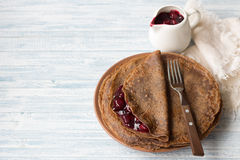 Chocolate pancakes with cherry sauce Stock Image