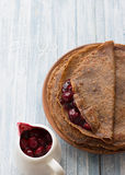 Chocolate pancakes with cherry sauce Stock Images