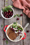 Chocolate pancakes with cherry and sour cream Stock Photo