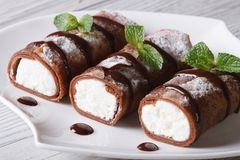 Chocolate Pancakes with cream cheese close-up horizontal Stock Image