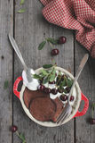 Chocolate pancakes with fresh cherries Royalty Free Stock Photography