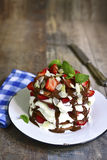 Chocolate pancakes with ricotta and strawberry. Stock Photography