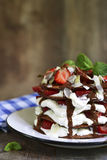 Chocolate pancakes with ricotta and strawberry. Stock Images