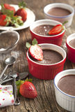 Chocolate Panna cotta with strawberry. Royalty Free Stock Images