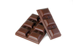 Chocolate. Parts of dark chocolate isolated Stock Photos