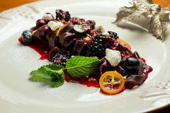 Chocolate pasta with raspberry sauce, whipped Stock Photo