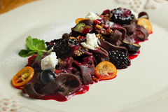 Chocolate pasta with raspberry sauce, whipped Stock Image