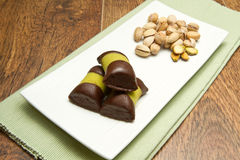 Chocolate pastries with pistachio Royalty Free Stock Photos