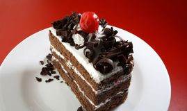 A chocolate pastry. Dish on a red background Royalty Free Stock Photography
