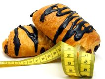 Chocolate pastry cakes & measuring tape Royalty Free Stock Images