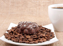Chocolate pastry lies on coffee bob Royalty Free Stock Images