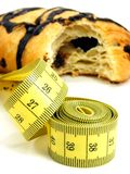 Chocolate pastry with measuring tape Stock Photo