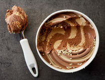 Chocolate and peanut ice cream. On dark gray table, top view Stock Image