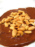 Chocolate and peanuts. Chocolate cream and peanuts close-up isolated Royalty Free Stock Photos
