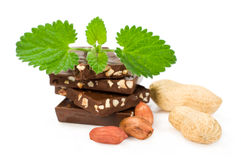Chocolate with peanuts and fresh mint leaves Stock Photos