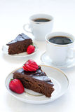 Chocolate pie and coffee. Two slices of a chocolate pie and two cups of coffee Royalty Free Stock Photos