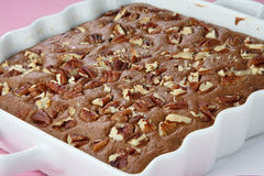 Chocolate pie dessert with walnut. On table Stock Photo