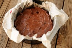 Chocolate pie dough in papered cake pan Royalty Free Stock Photo