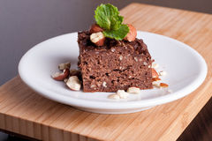 Chocolate pie with nuts, decorated mint Stock Image
