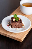 Chocolate pie with nuts, decorated mint Royalty Free Stock Image
