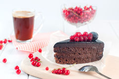 Chocolate pie with red current on white background Royalty Free Stock Photo