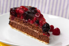 Chocolate pie(Tart) with cream,cherry,raspberry, a Royalty Free Stock Image